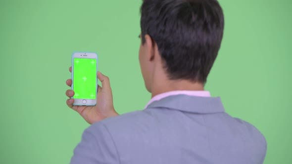 Thumbnail for Closeup Rear View of Happy Young Businessman Using Phone