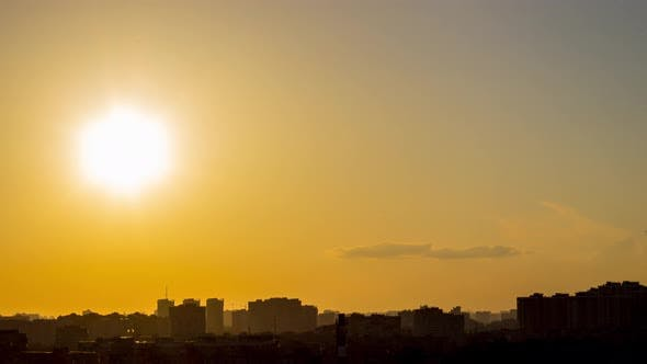 Thumbnail for Sunrise Over City Buildings Silhouettes.