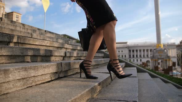 Cover Image for Businesswoman's Legs in Heels Stepping Down Stairs