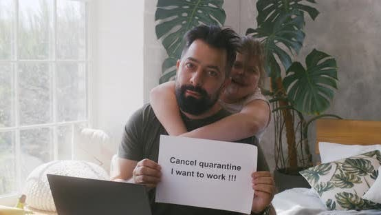 Thumbnail for Man Showing Anti-quarantine Message To Camera