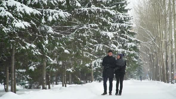 Man and Woman Walk in Winter Park