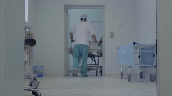 Thumbnail for Orderlies Take Medical Instruments From the Operation Unit