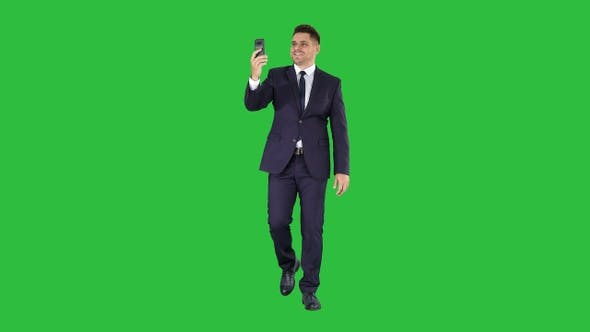 Thumbnail for Young businessman using smartphone to videocall to business