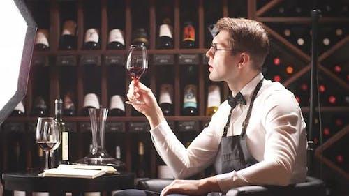Wine Taster Writing in Notepad Information of Wine Origin and Taste