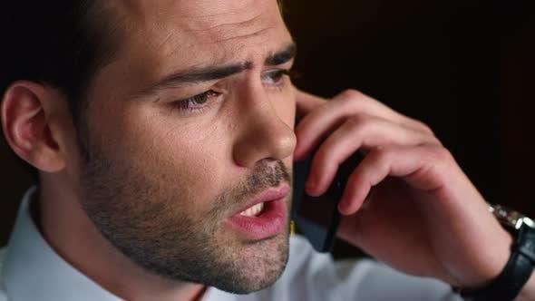 Thumbnail for Businessman Face Talking on Smartphone. Entrepreneur Having Phone Conversation