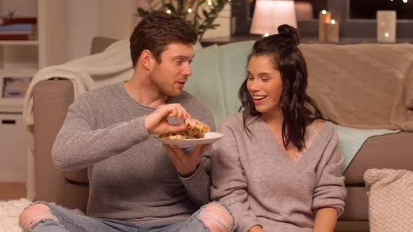 Thumbnail for Couple Eating Waffles with Hot Chocolate at Home