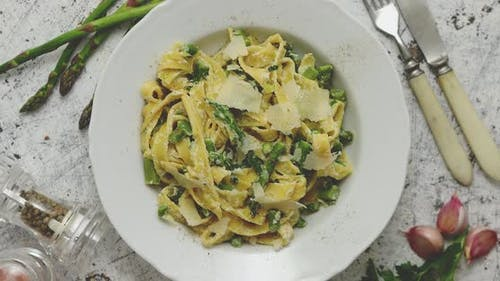 Tagliatelle Pasta with Creamy Ricotta Cheese Sauce and Asparagus Served White Ceramic Plate