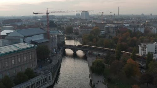 AERIAL: Over Bridge of Berlin, Germany City Center River in Fall Colors Towards Berlin