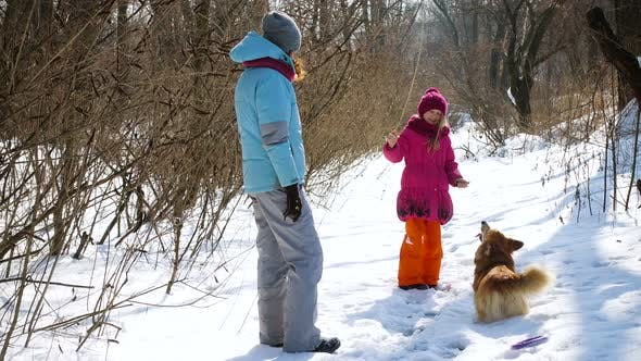 Thumbnail for Happy Mother With Daughter In The Winter Park 2