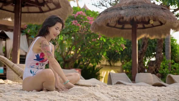 Thumbnail for Beautiful Woman Building a Sand Castle in Sps Resort