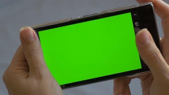 Mobile phone green screen in 4K UHD 2160p footage - Smart phone using green screen 4K 3840X2160 UHD