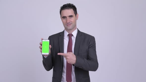 Thumbnail for Happy Handsome Businessman Showing Phone and Giving Thumbs Up