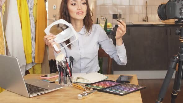 Attractive Female Blogger Writes Videos Online Tutorials for Subscribers