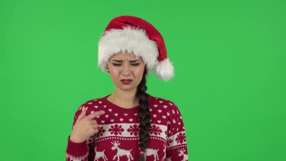 Thumbnail for Portrait of Sweety Girl in Santa Claus Hat Is Outraging and Refusing, Gesticulating with Hands
