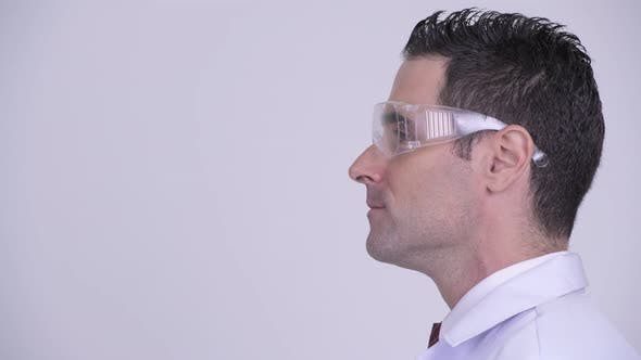 Thumbnail for Head Shot Profile View of Handsome Man Doctor Wearing Protective Glasses Thinking