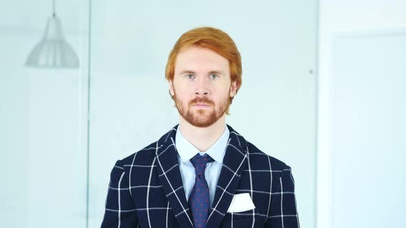 Thumbnail for Serious Redhead Businessman with Red Hairs in Office