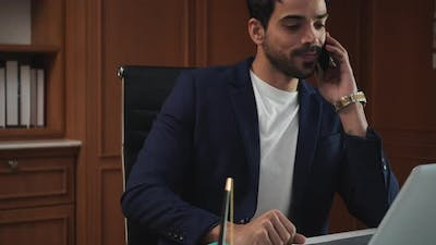 Business man using laptop and smartphone