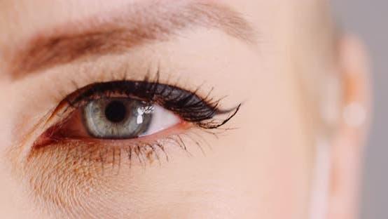 Thumbnail for Macro Shot of Blue Eye Opening Human Iris. Womans Eye
