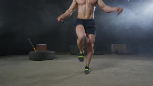 Thumbnail for Muscular Man Training with Jump Rope