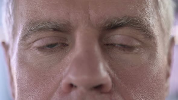 Thumbnail for Close Up of Serious Middle Aged Man Eyes Looking at Camera