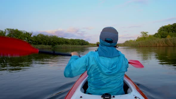 Thumbnail for A Woman Is Kayaking
