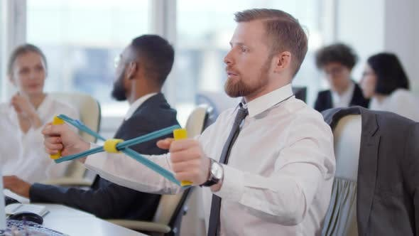Thumbnail for Businessman Exercising with Chest Expander