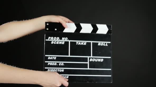 Thumbnail for Hands Use Movie Production Clapper Board, on Black, Slow Motion