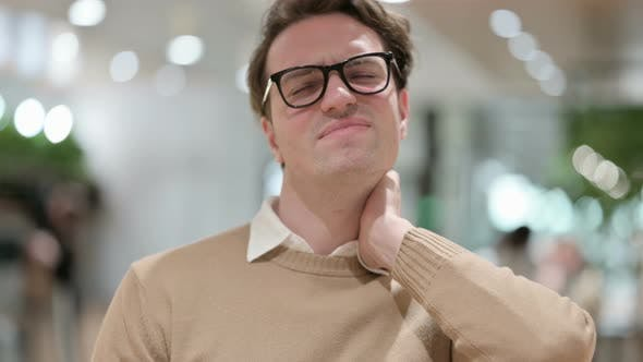 Young Male Designer Having Neck Pain
