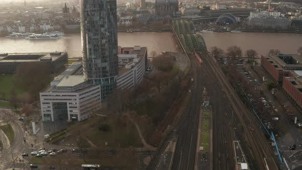 Thumbnail for AERIAL: Train Crossing Cologne Hohenzollern Bridge on Sunny Day with Haze in the Sky