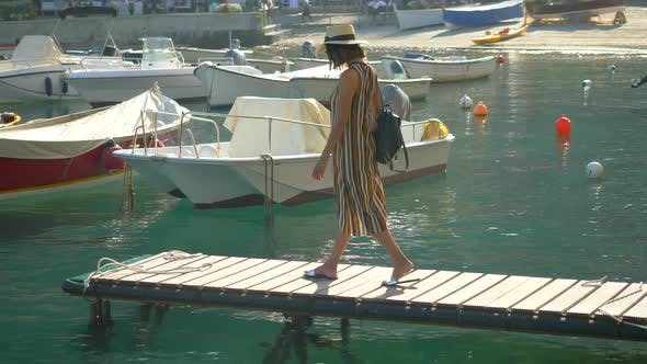 Thumbnail for A woman on a boat dock in Portofino, Italy, a luxury resort town in Europe