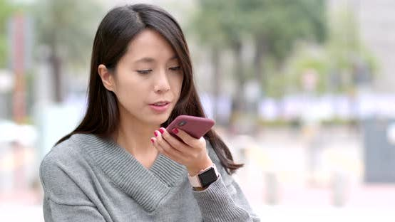 Woman use of cellphone for audio message