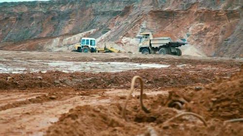 Large Yellow Dumper Truck in Open Cast Mine Landscape. Dirty Tipper Truck