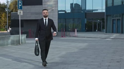 Cheerful Businessman with Briefcase Going To Office and Jumping
