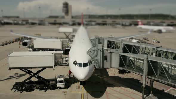 Thumbnail for Commercial Airplane Standing at Airport Terminal