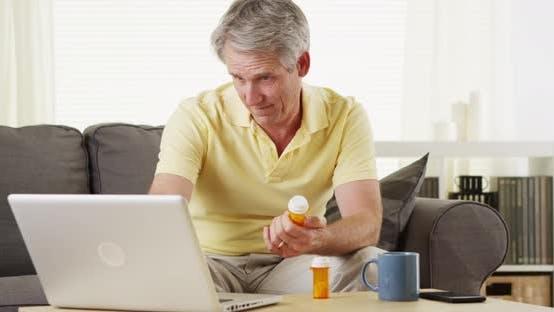 Thumbnail for Senior man checking laptop for digital prescription
