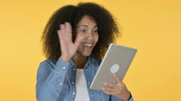 Thumbnail for Video Chat on Tablet By African Woman, Yellow Background