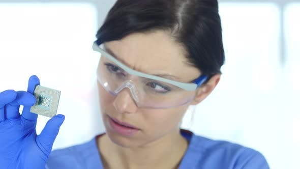 Thumbnail for Scientist Looking at Computer Chip