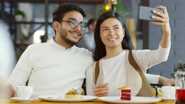 Thumbnail for Smiling Couple Taking Selfie with Smartphone in Cafe