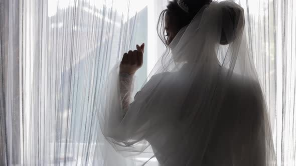 Thumbnail for Beautiful and Lovely Bride in Night Gown and Veil. Wedding Morning Preparation