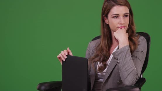 Thumbnail for Businesswoman holding tablet thinking analyzing data on green screen