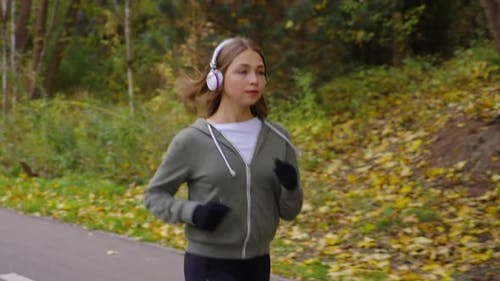 Woman Listening to Audio Book While Jogging
