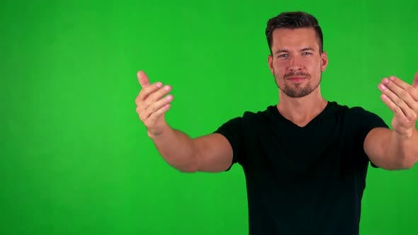 Thumbnail for Young Handsome Caucasian Man Welcomes - Green Screen - Studio