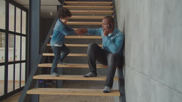 Thumbnail for Lovely Little Boy Talking on Cellphone on Stairs