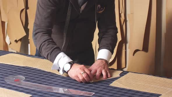 Thumbnail for Qualified Creative Designer Male Working in Showroom Making Patterns for Sewing on Textile Materials