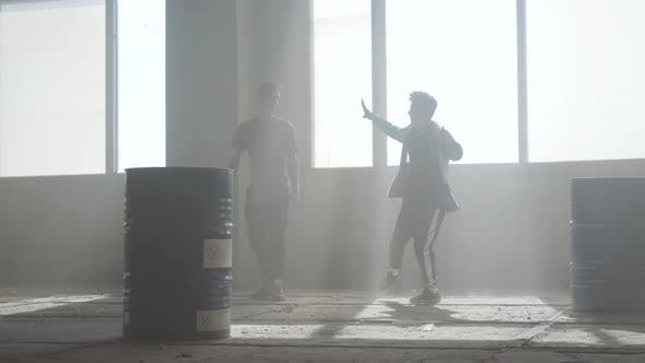 Cover Image for Dance Battle of Two Street Dancers in an Abandoned Building Near the Barrel