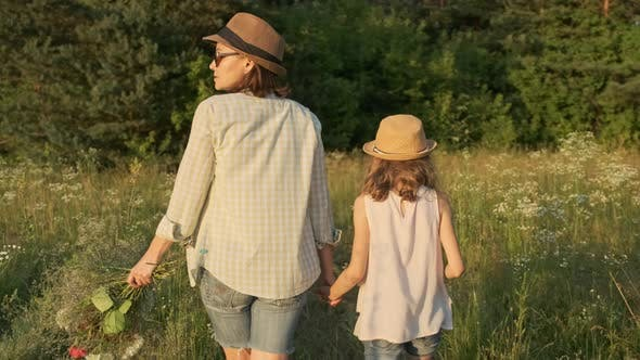 Cover Image for Mother and Daughter Walking Holding Hands, Back View