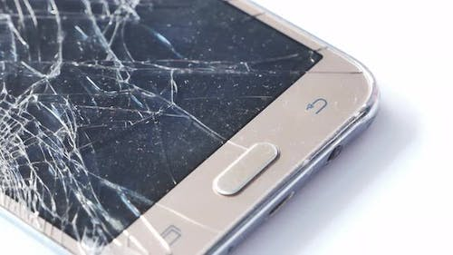 Close Up of Broken Smart Phone on White Background