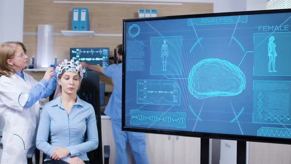 Tv Screen with Brain Activity From Female Wearing Brain Scanner