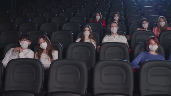 Thumbnail for Young Adults Wearing Face Masks in Cinema Hall.