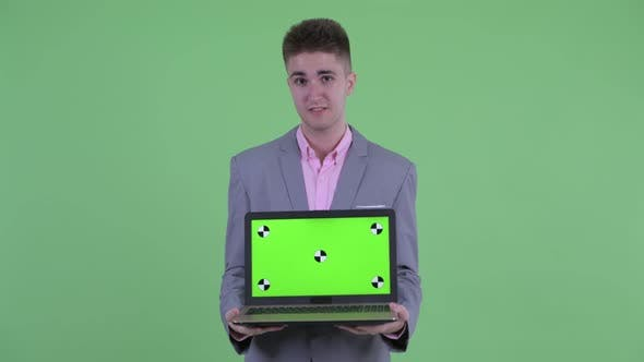 Thumbnail for Happy Young Businessman Talking While Showing Laptop